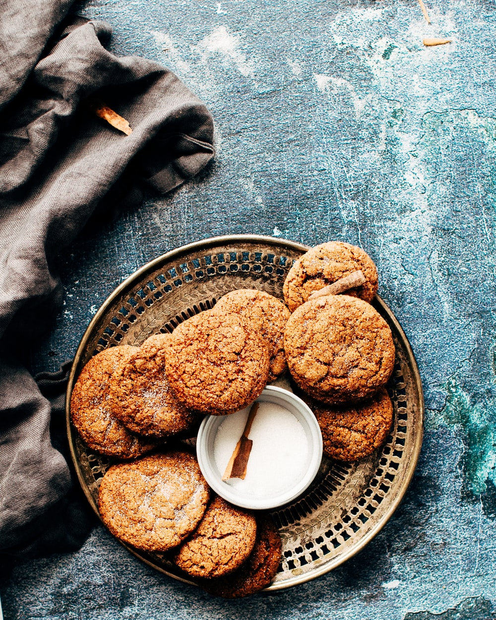 platter of cookies on top of blue surface