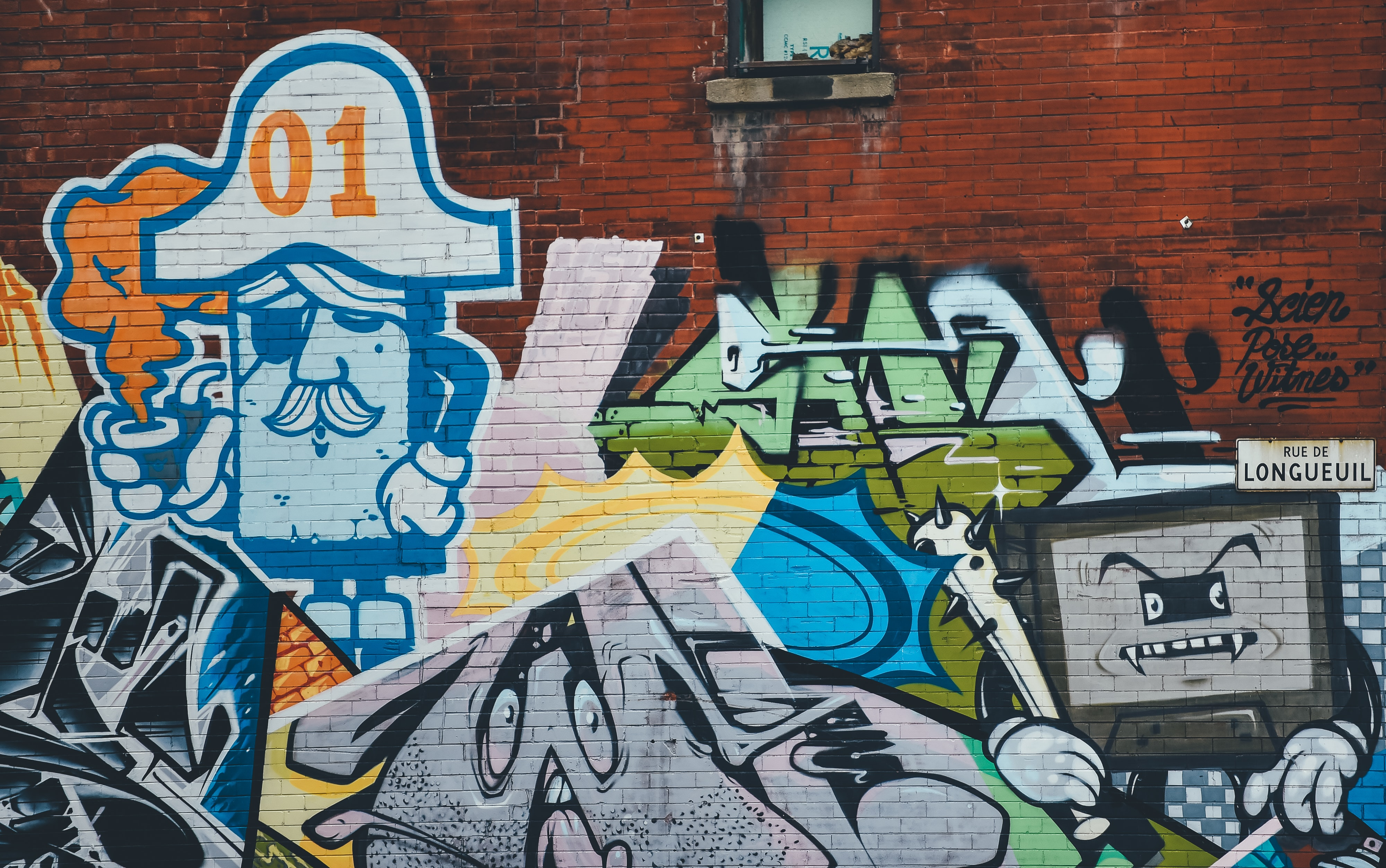 A graffiti painting of a character shaped as a TV.
