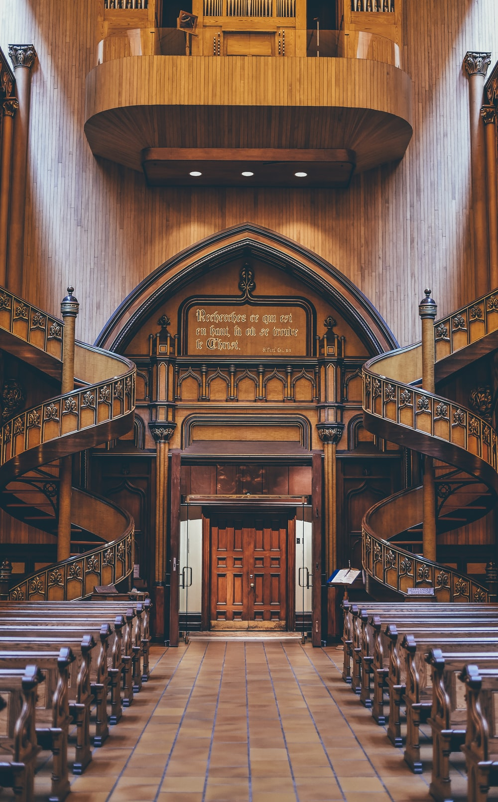 brown wooden pews inside church