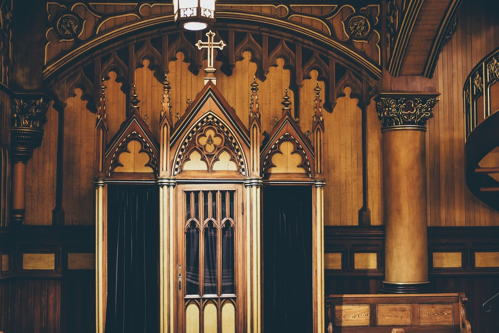 brown and black wall inside the cathedral
