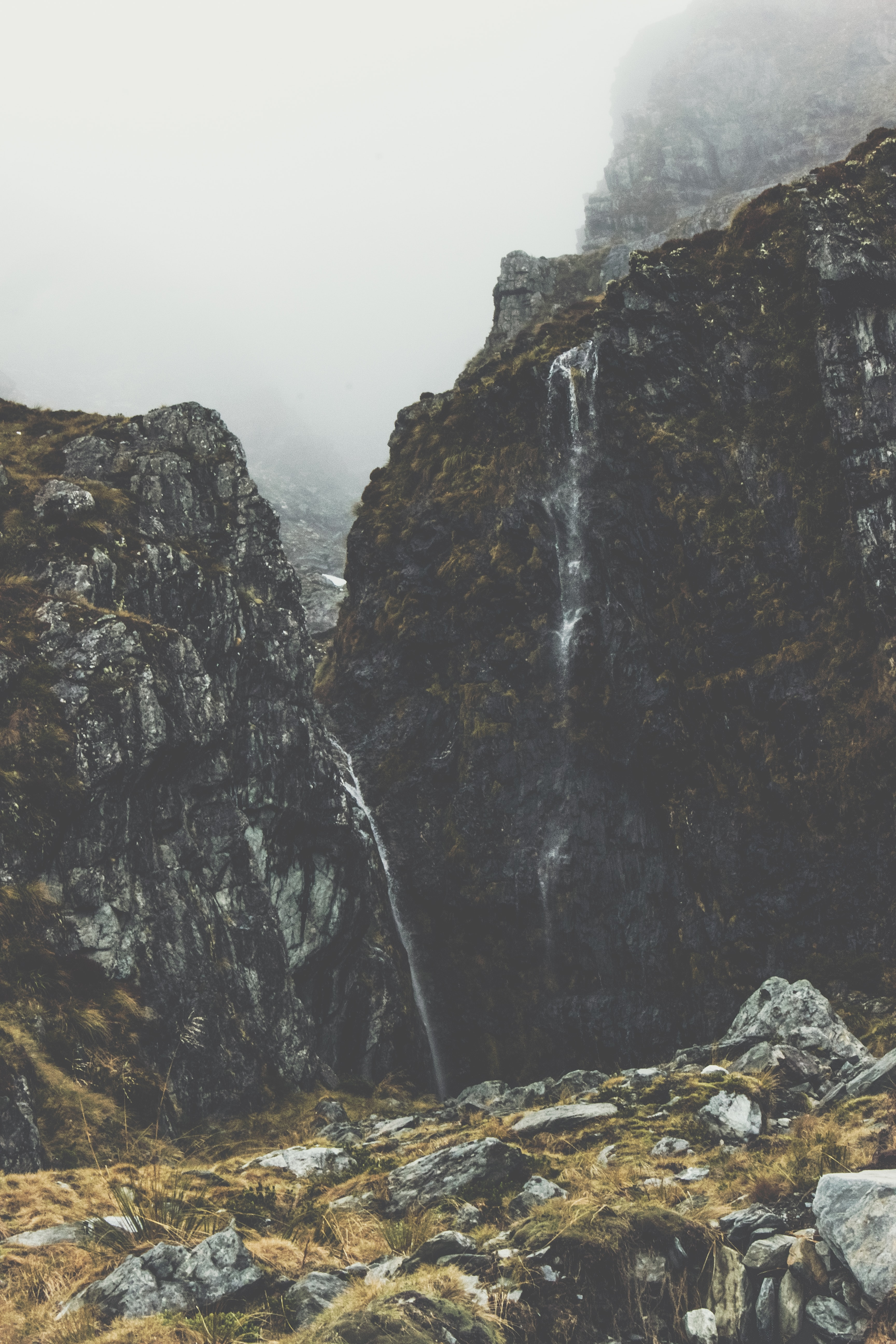photography of foggy waterfalls