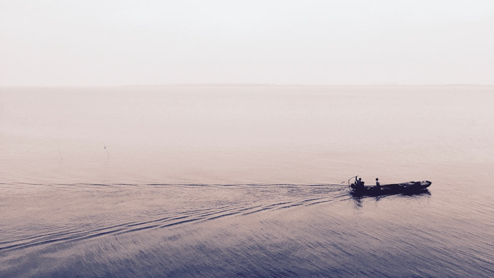 boat moving on body of water