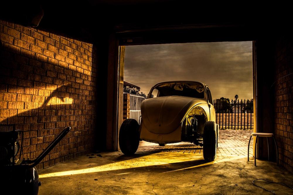 gray Volkswagen Beetle in garage