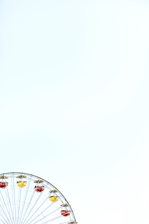 black ferris wheel under clear skies