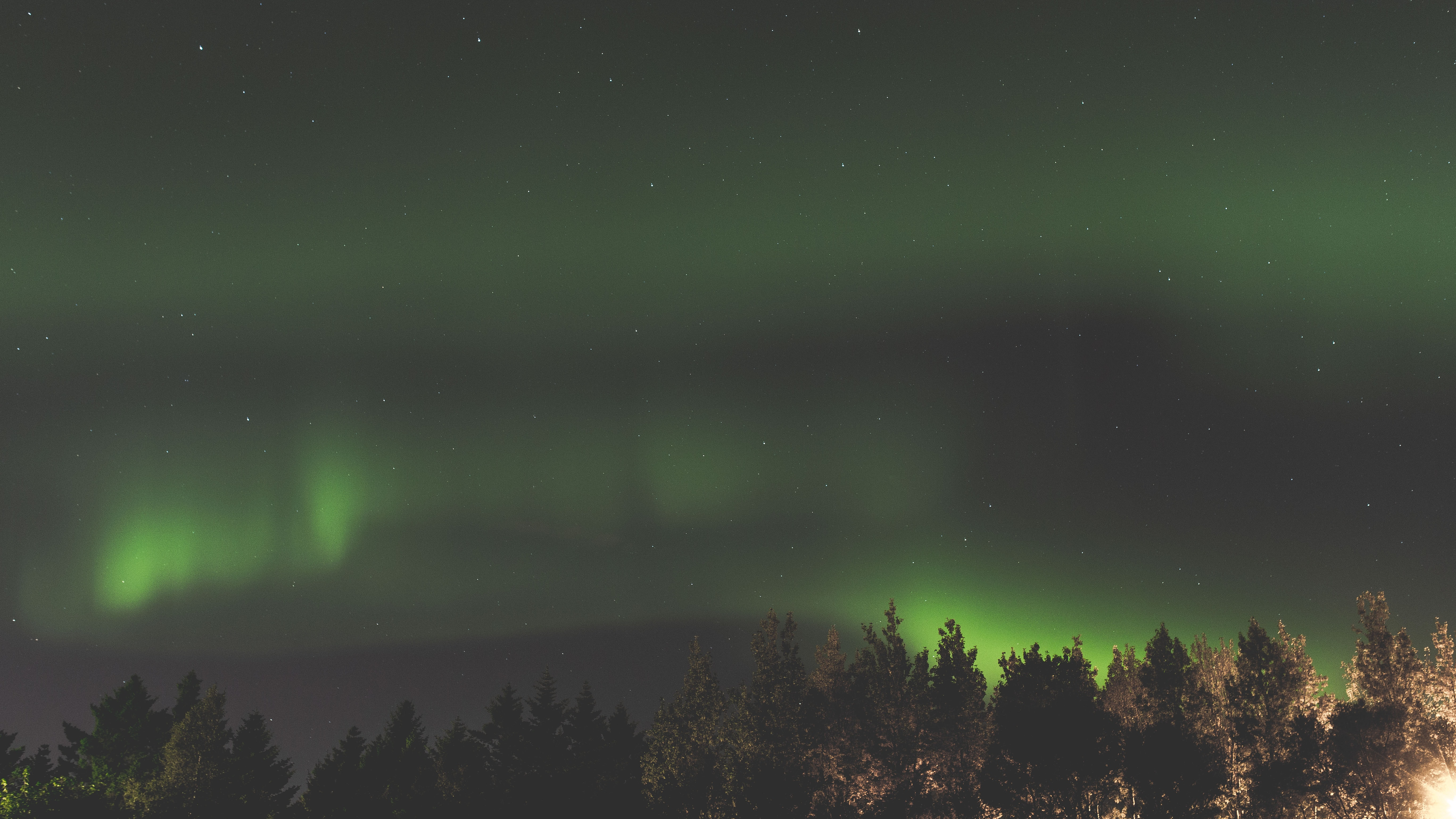 The beautiful Northern Lights viewed from a mountain top.