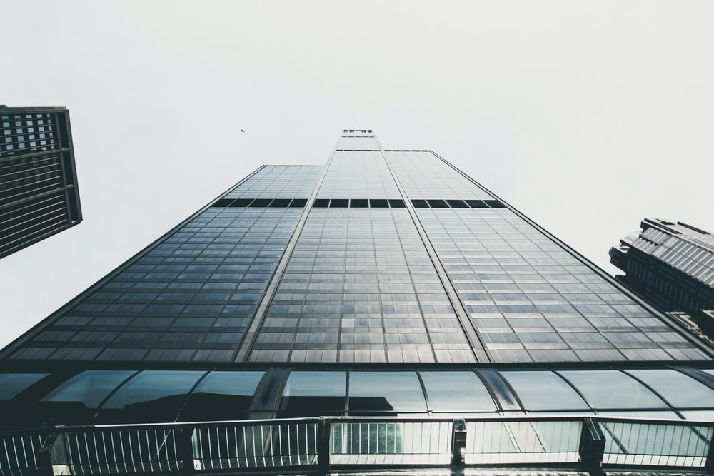 photography of black high-rise building
