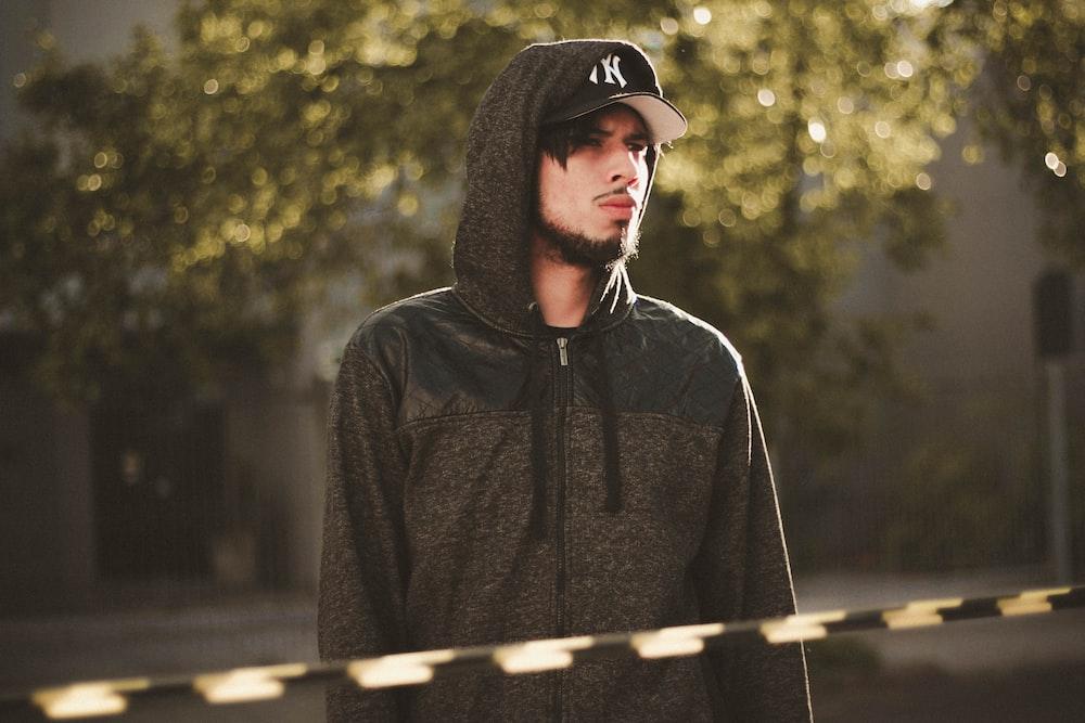man in black zip-up hoodie