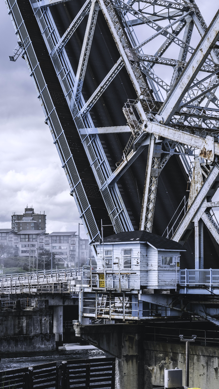 Industrial drawbridge lifts up in an urban Victoria area