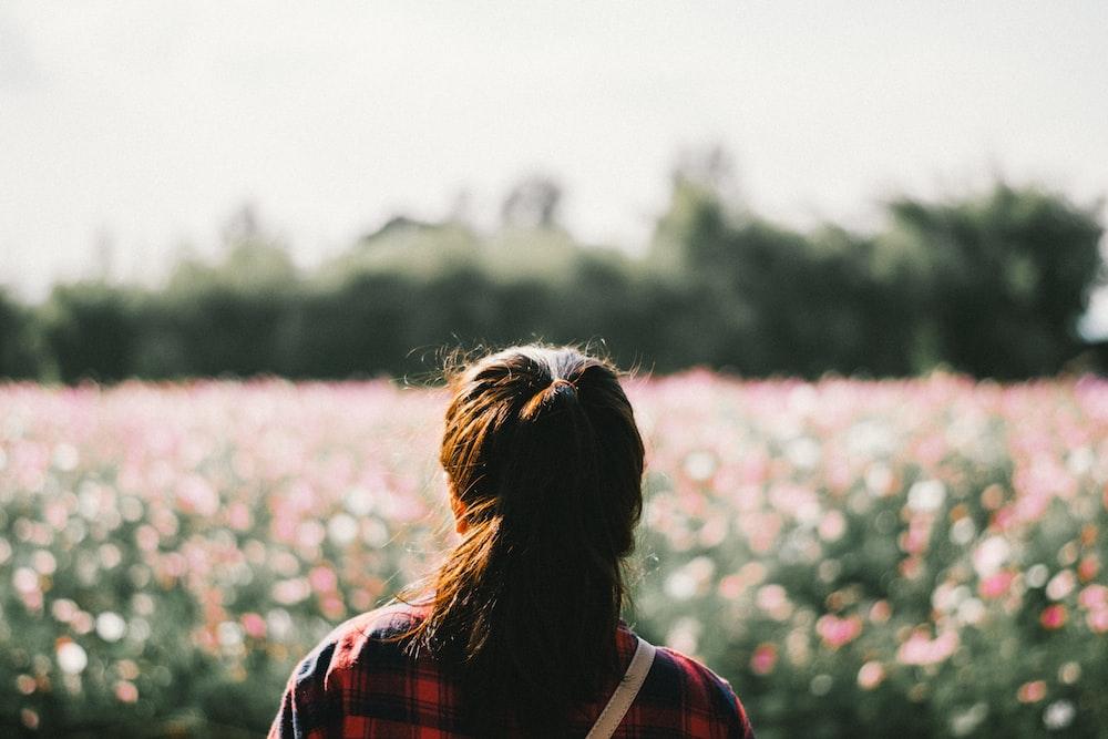 woman standing in front of garden