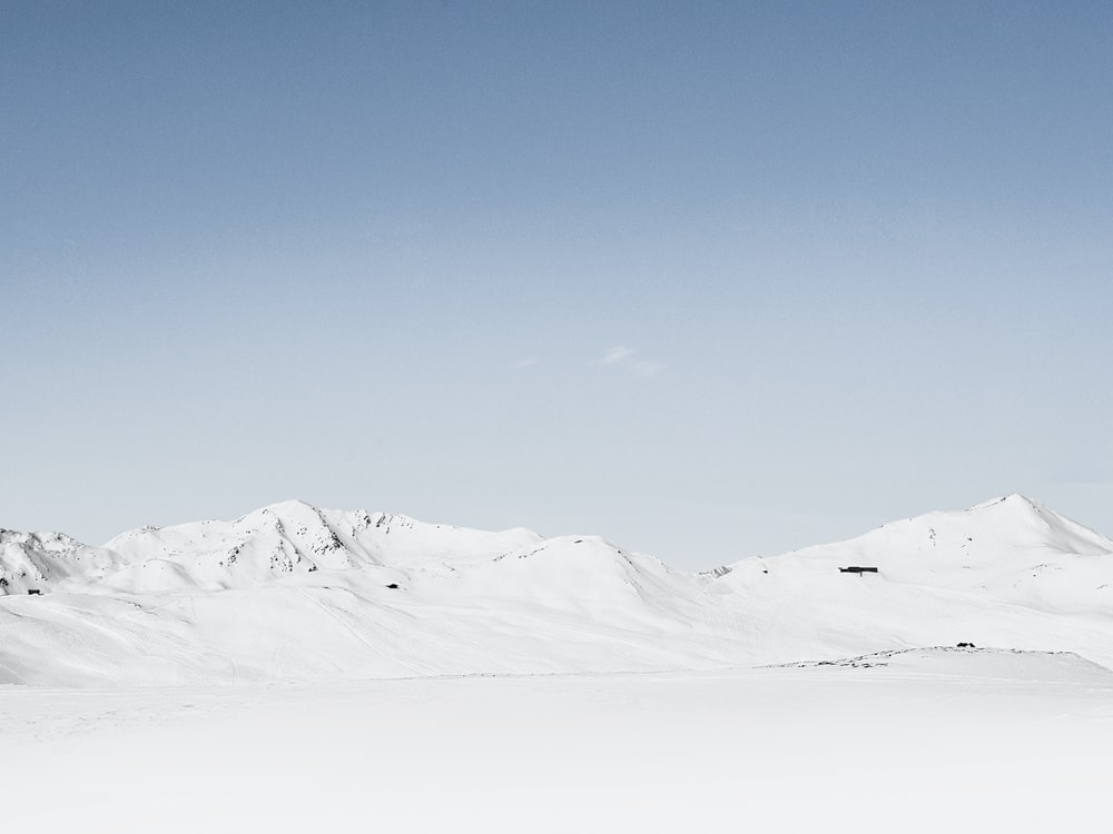 photography of snow covered mountain at daytime