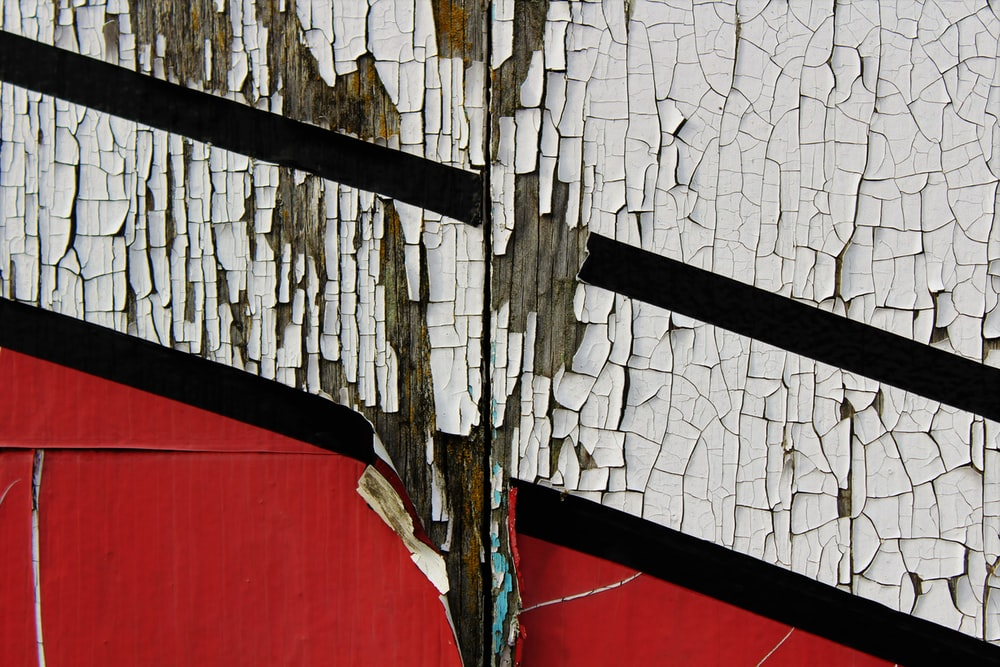 scratched white and red painted wall