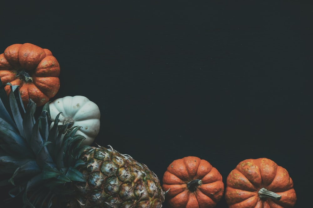 close-up photo of pineapple and pumpkin