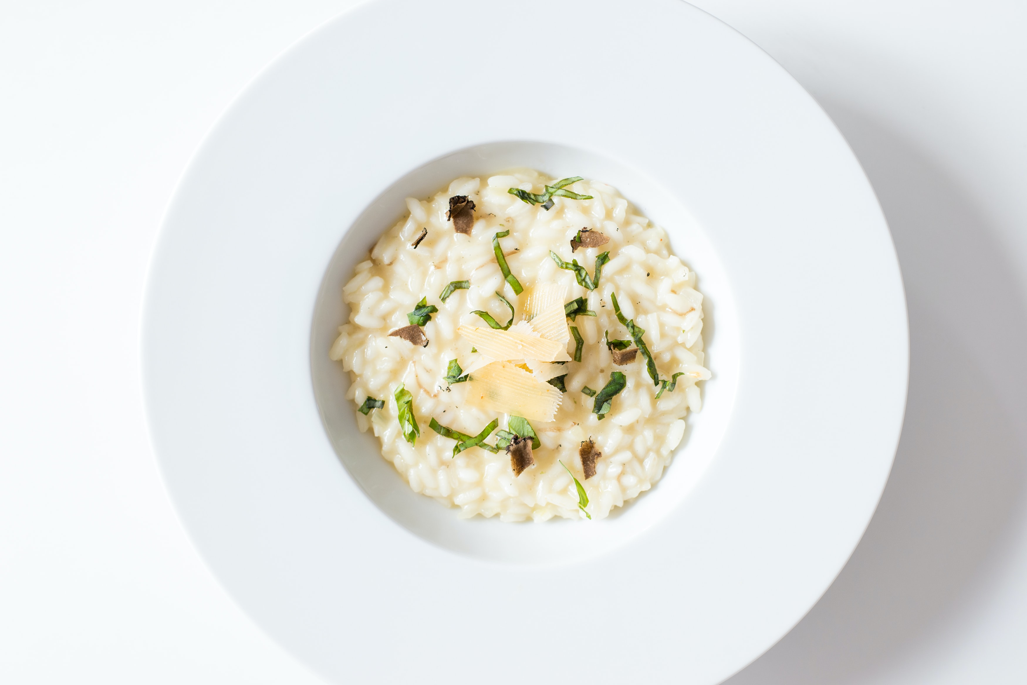Bowl of risotto with rice, cheese, and herbs for dinner