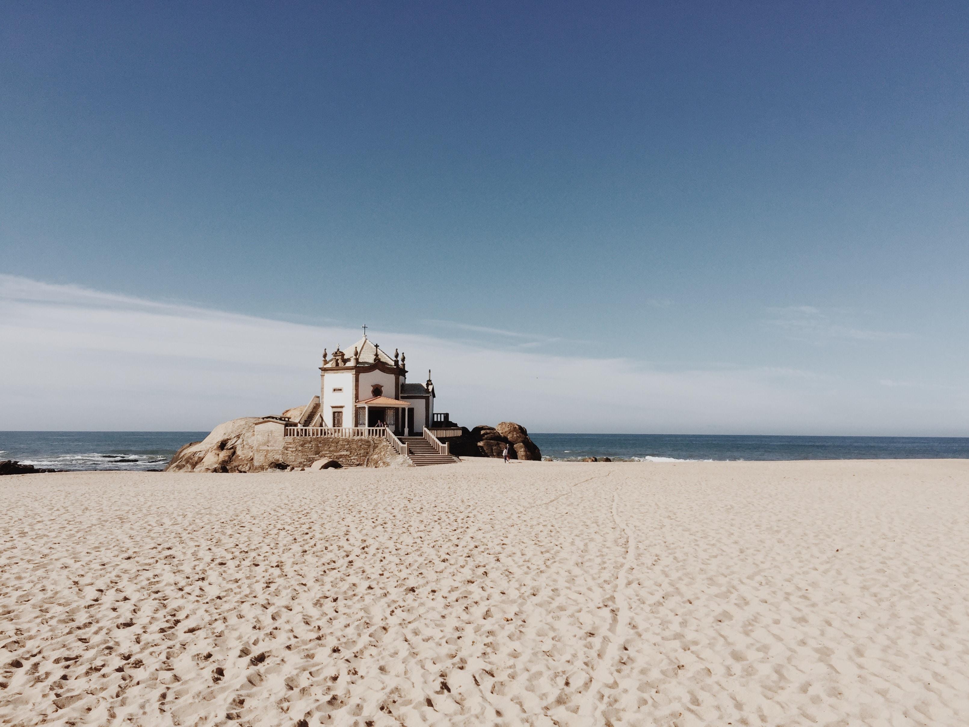 House on rocks at the sand beach in Vila Nova de Gaia, Porto, Portugal