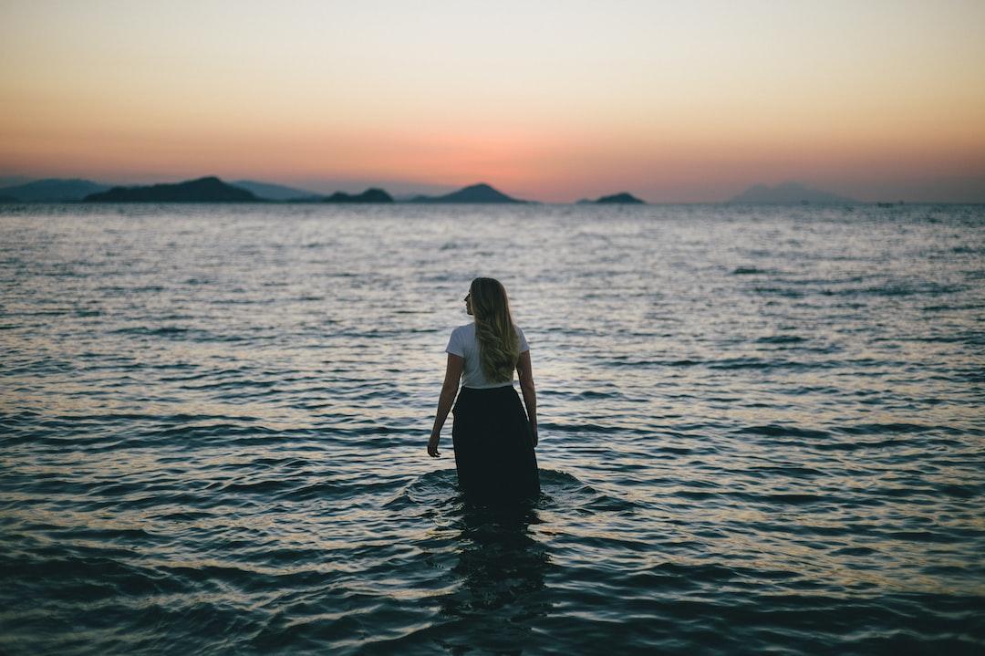 Woman walking through waves