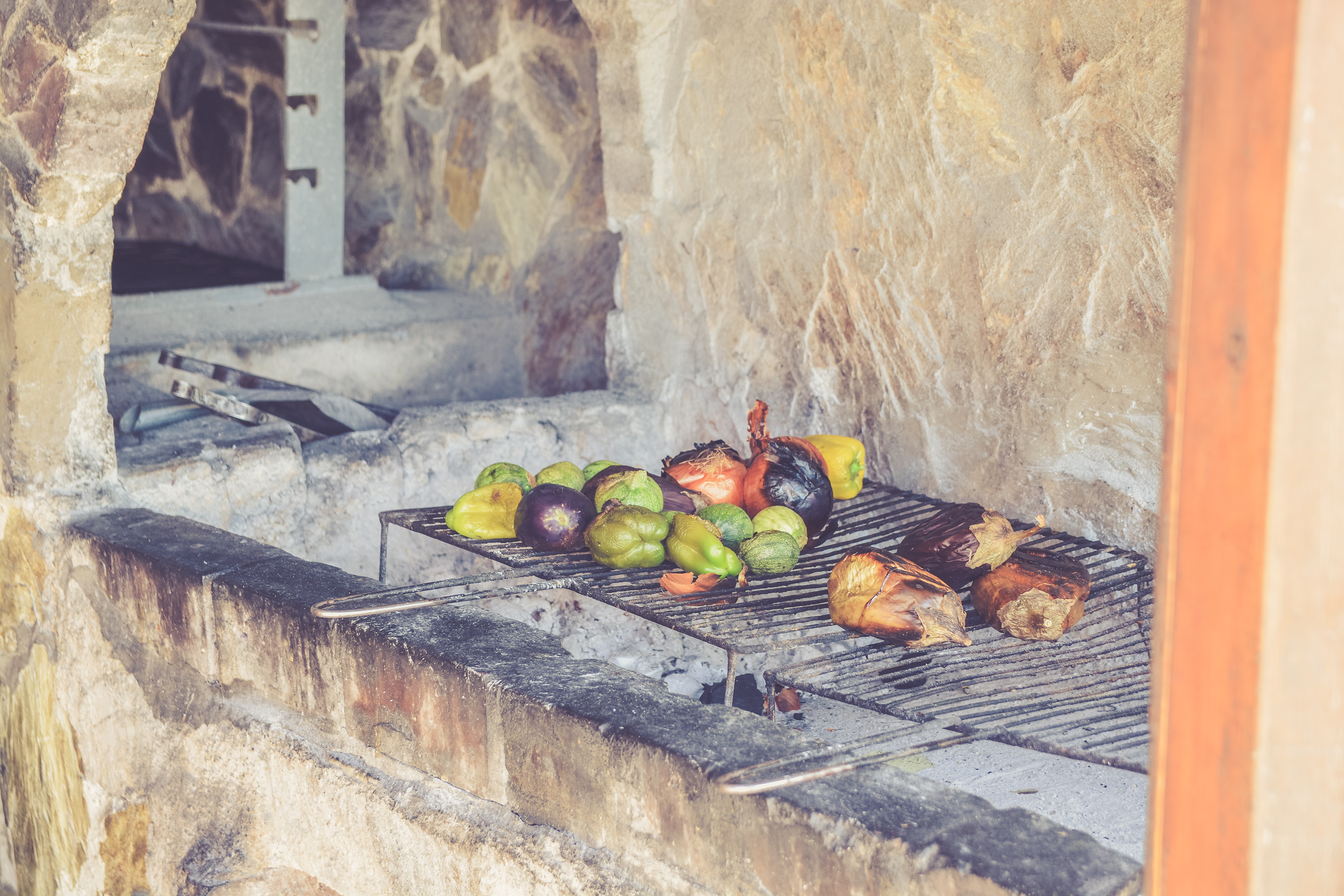 Peppers, onion and squash on a rustic grill