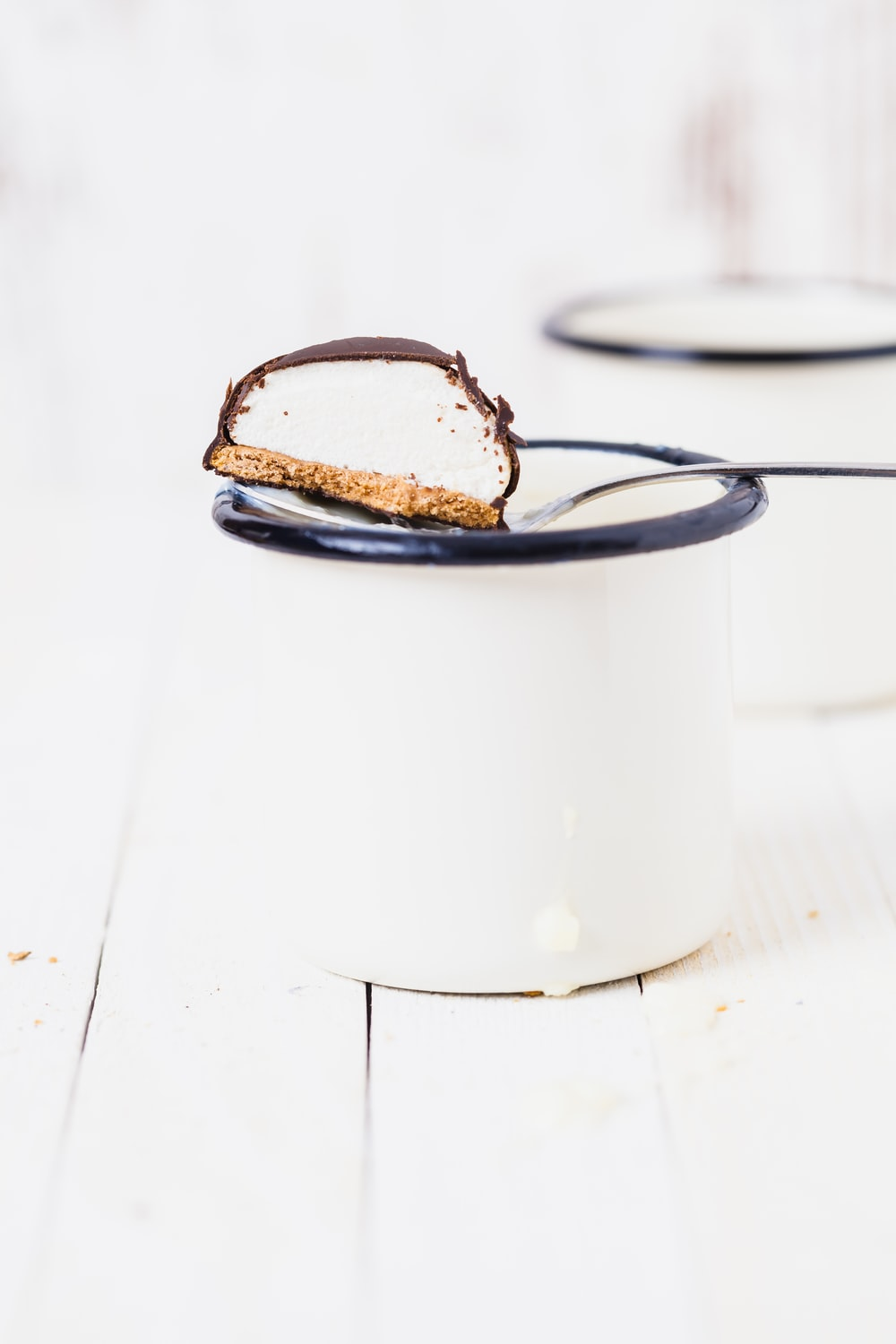 chocolate biscuit in white mug