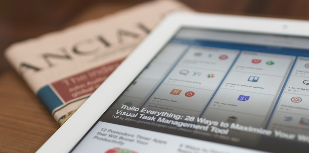 Close-up of a tablet laid out on a newspaper