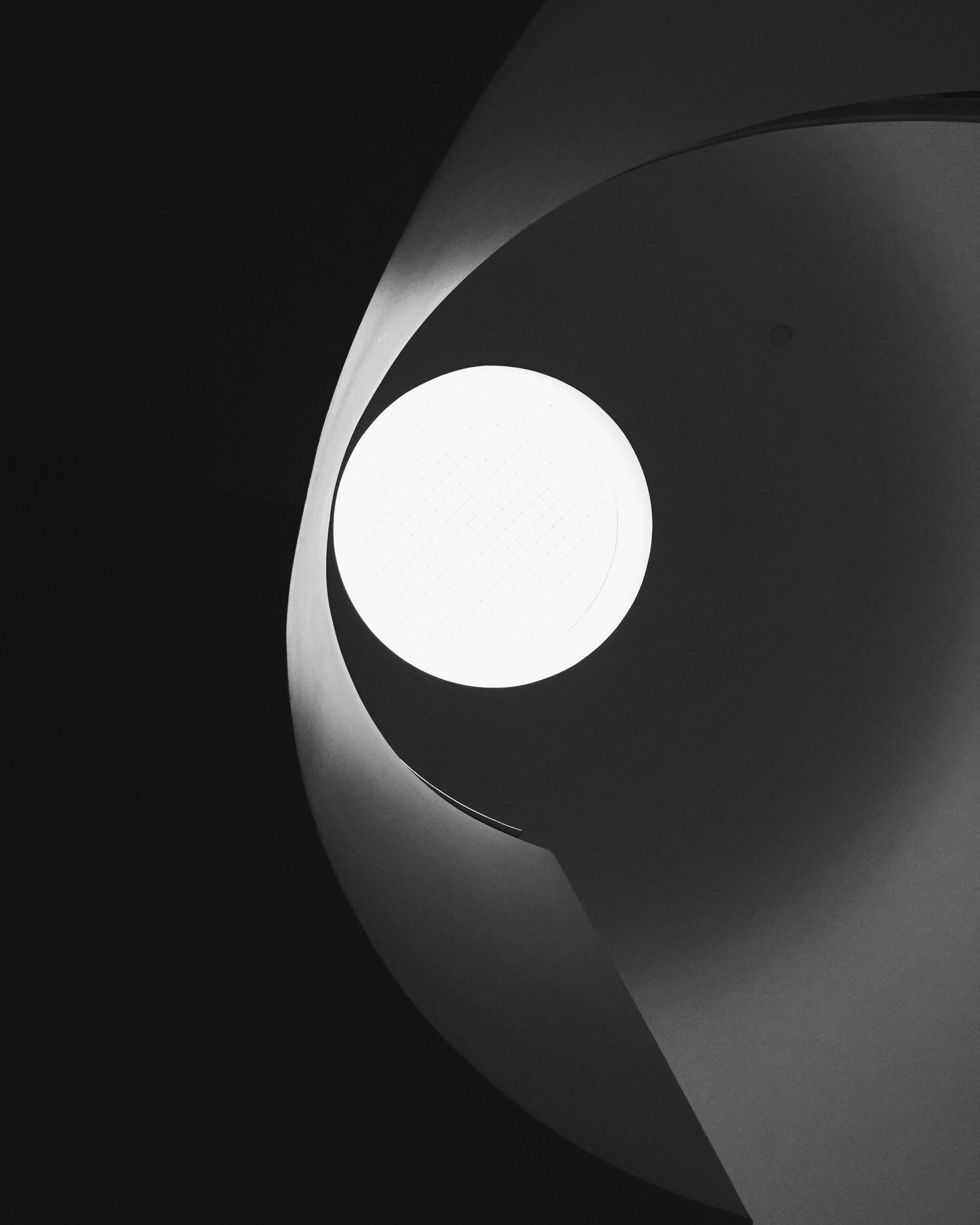 low angle photo of round pendant lamp