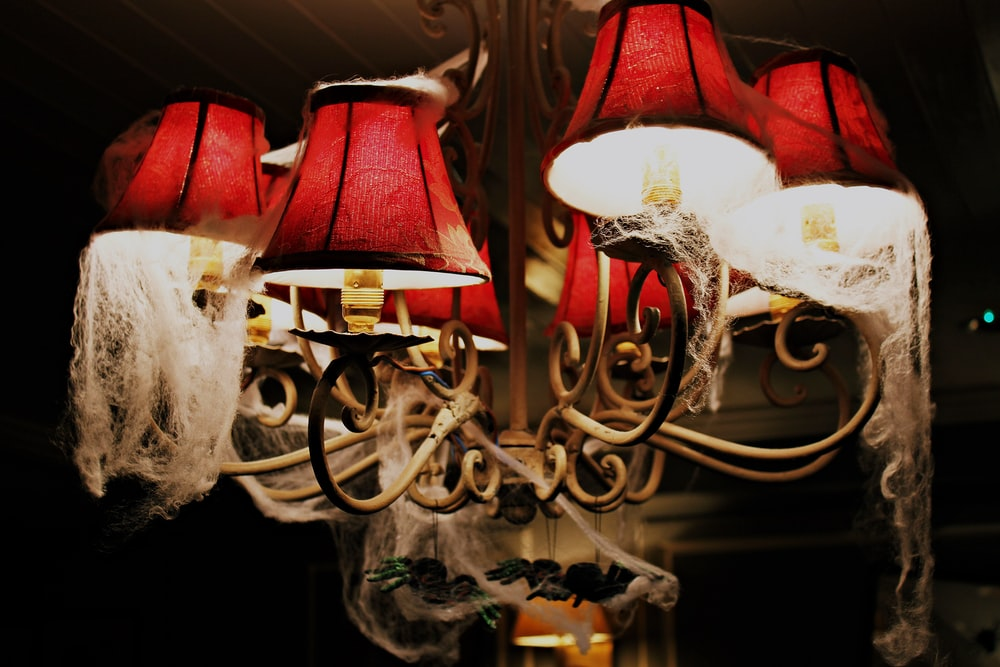 red and brown uplight chandelier