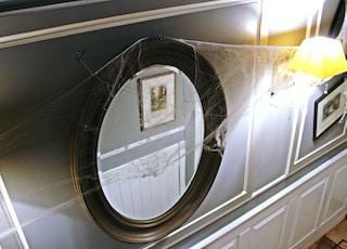 round black-framed mirror