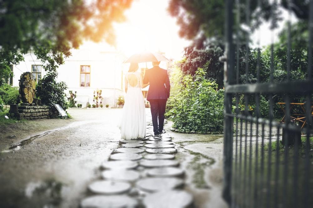 bride and groom walking on pathway