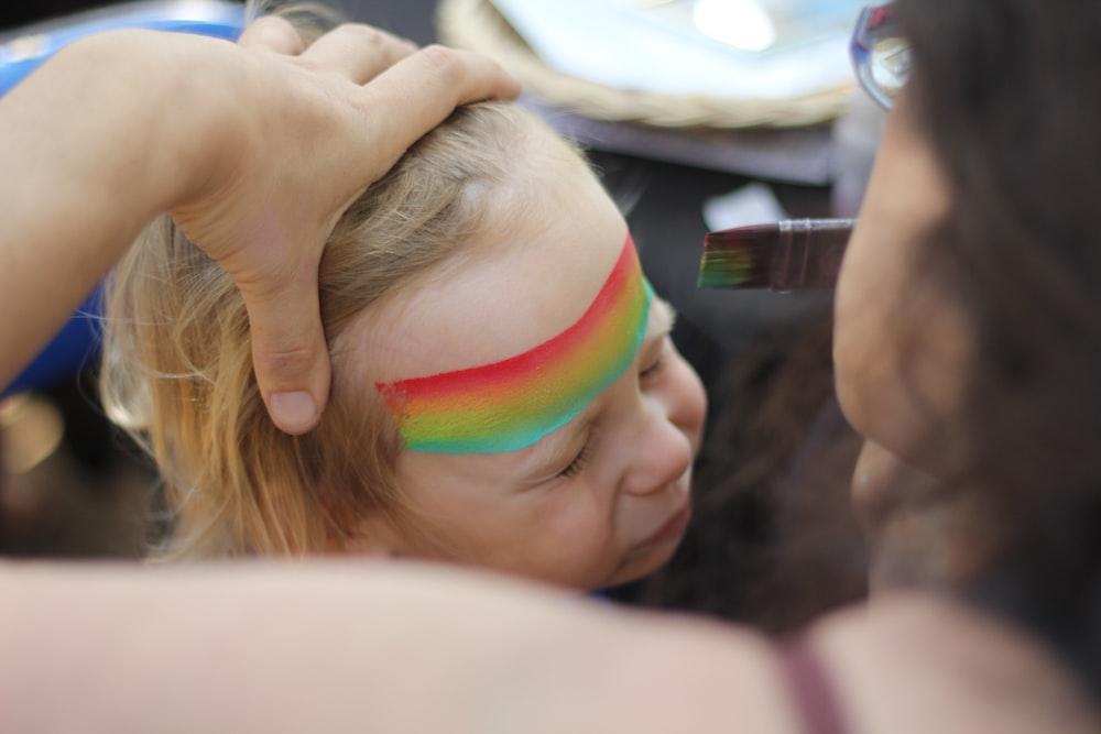 woman stroking child's hair