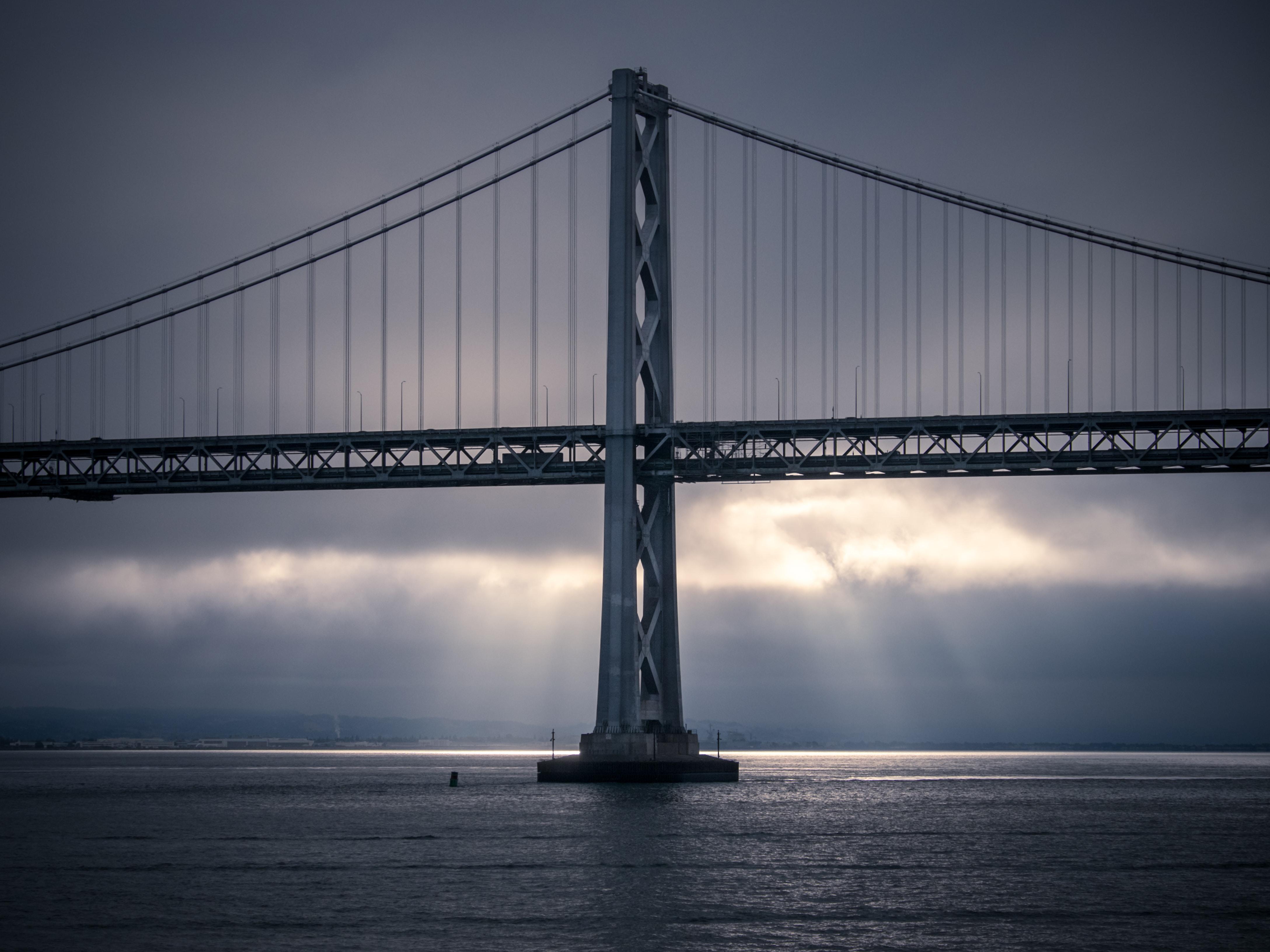 architectural photo of gray metal bridge during daytime