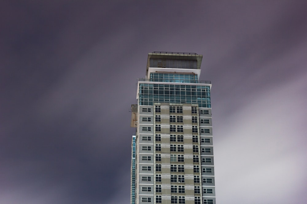 high rise building under cloudy sky