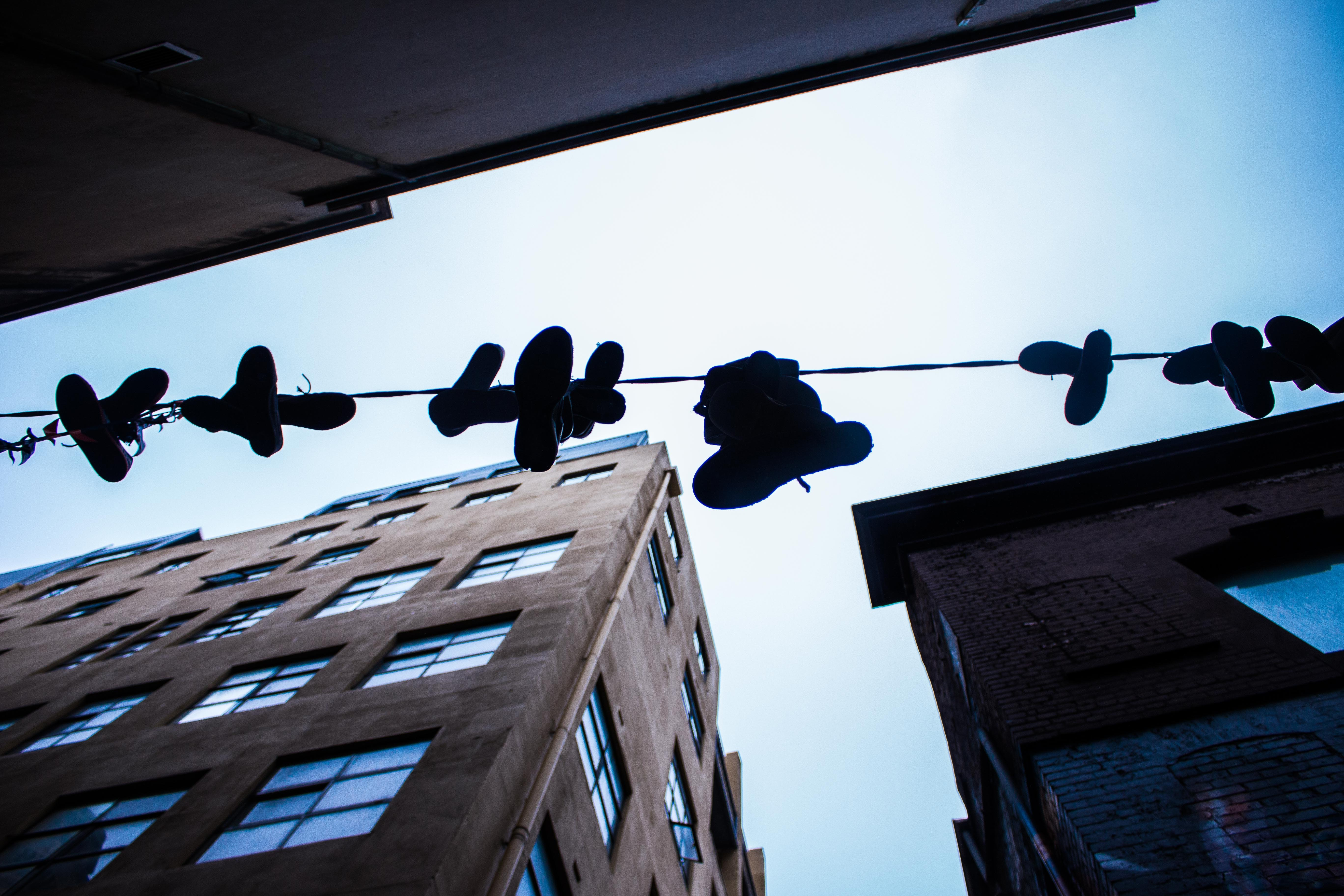 Sneakers hanging on a telephone line attached to a building on Hosier Lane