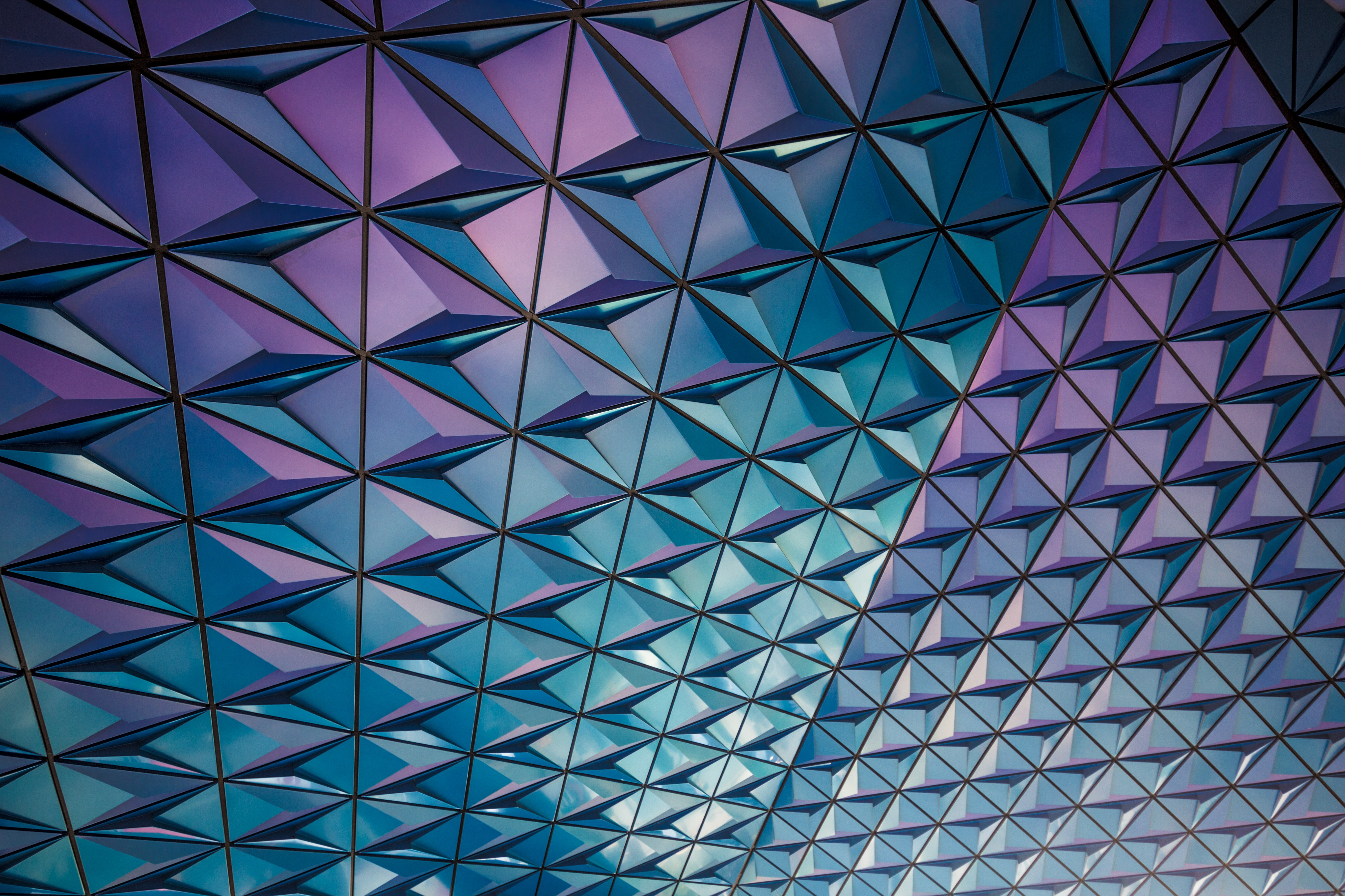 A mosaic of blue and purple triangles in a facade