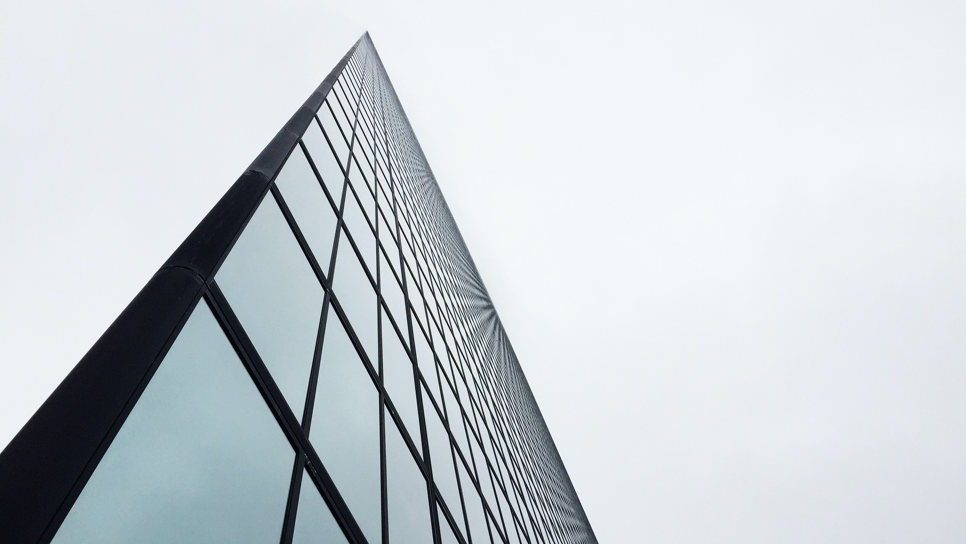 An angular shot of a tall glass facade in Boston