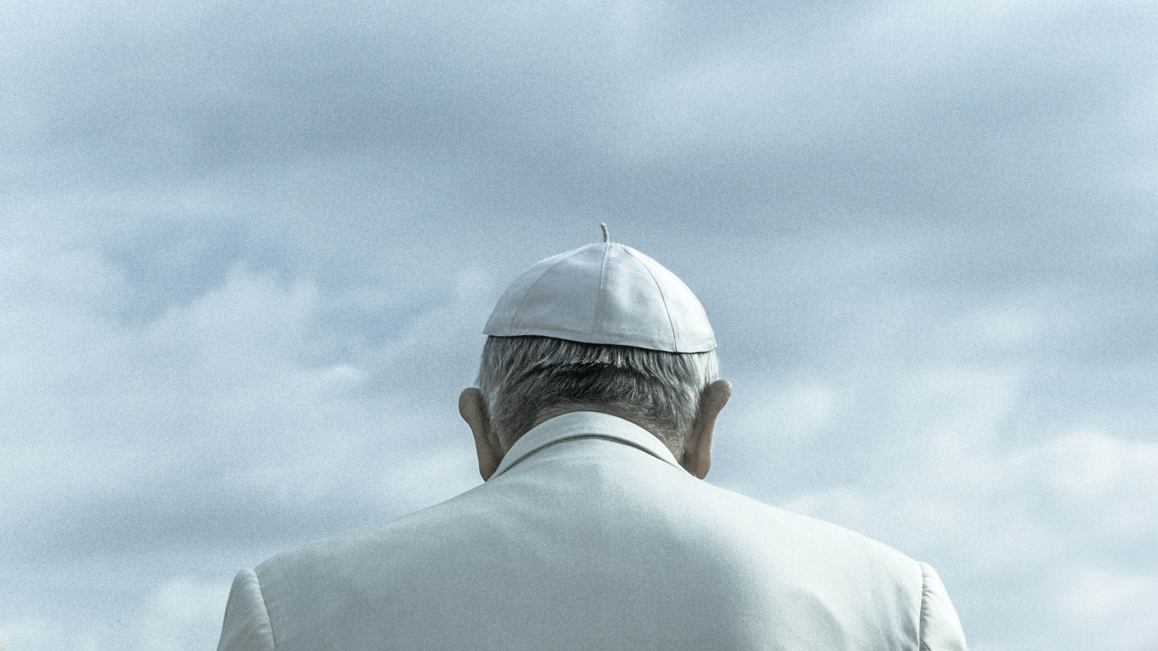 A view from behind the Pope of his shirt and hat, taken in Vatican City