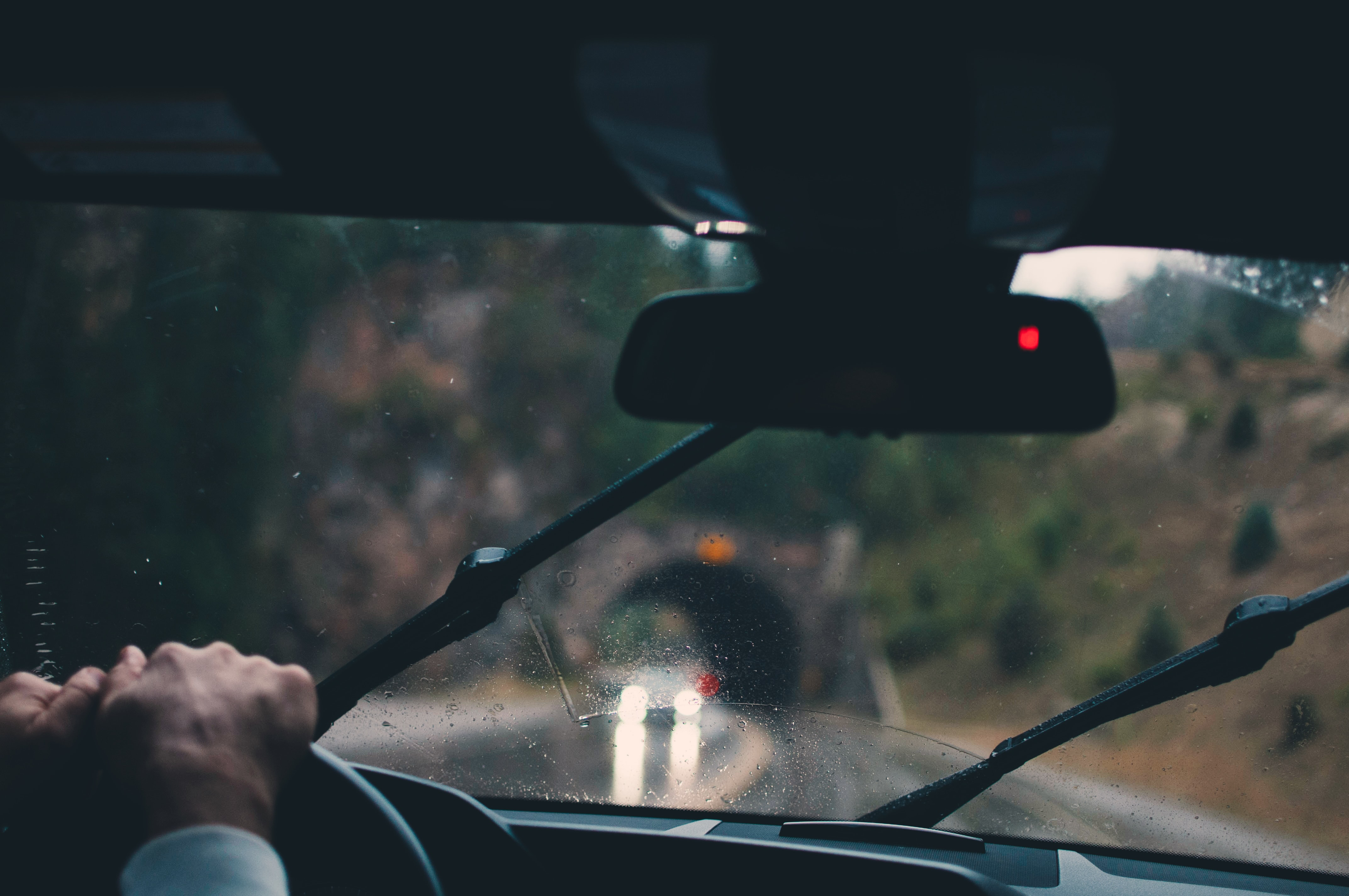 shallow focus photography of person driving