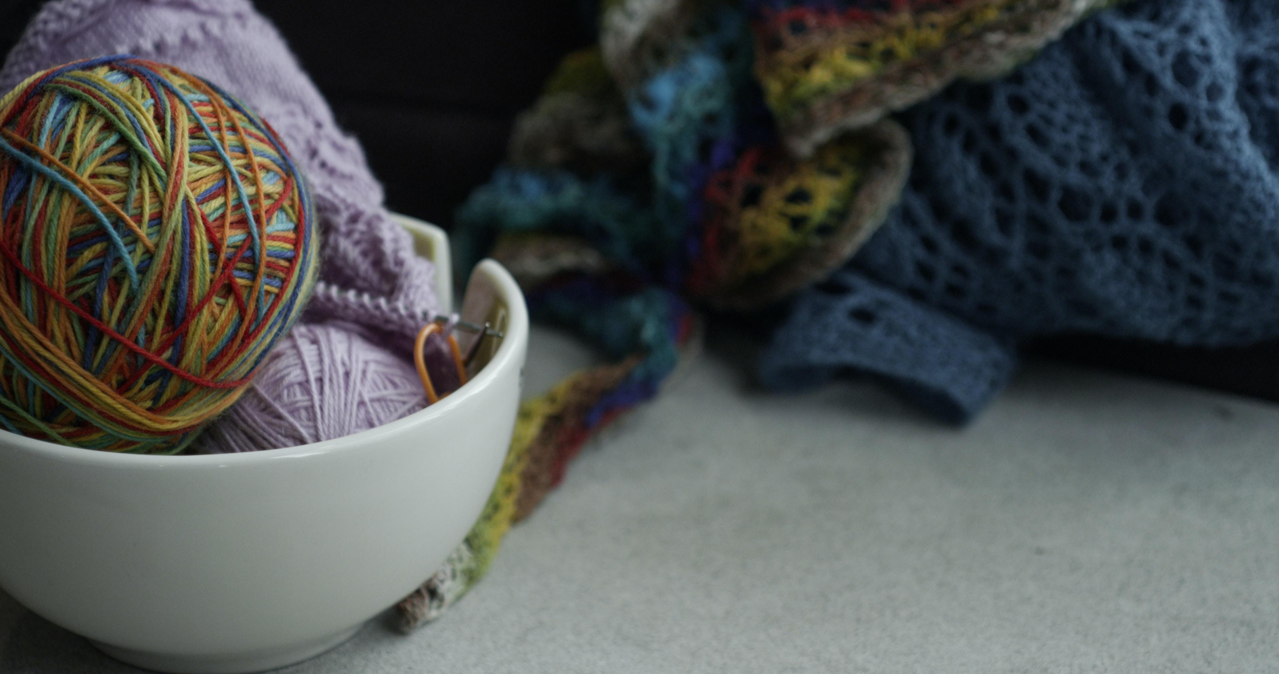 yarn balls on white bowl