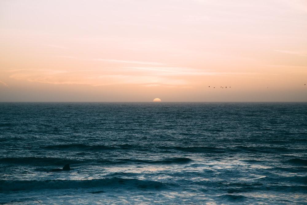 sea waves under sunset