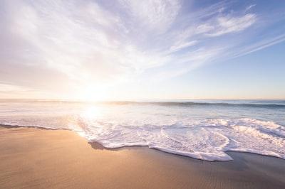 Sunrise above a sandy beach