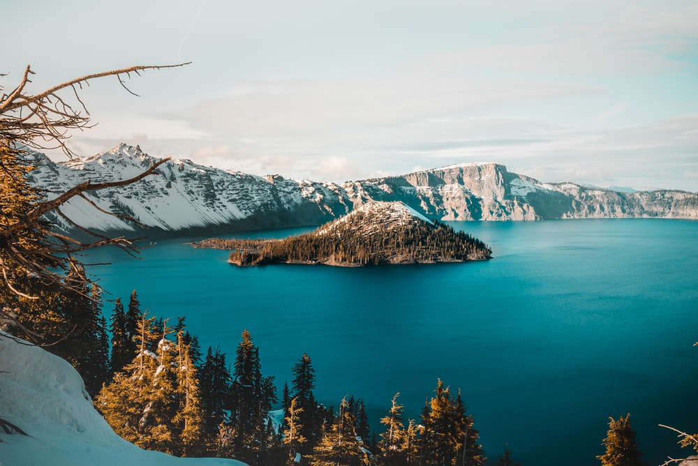 landscape photography of island in lake