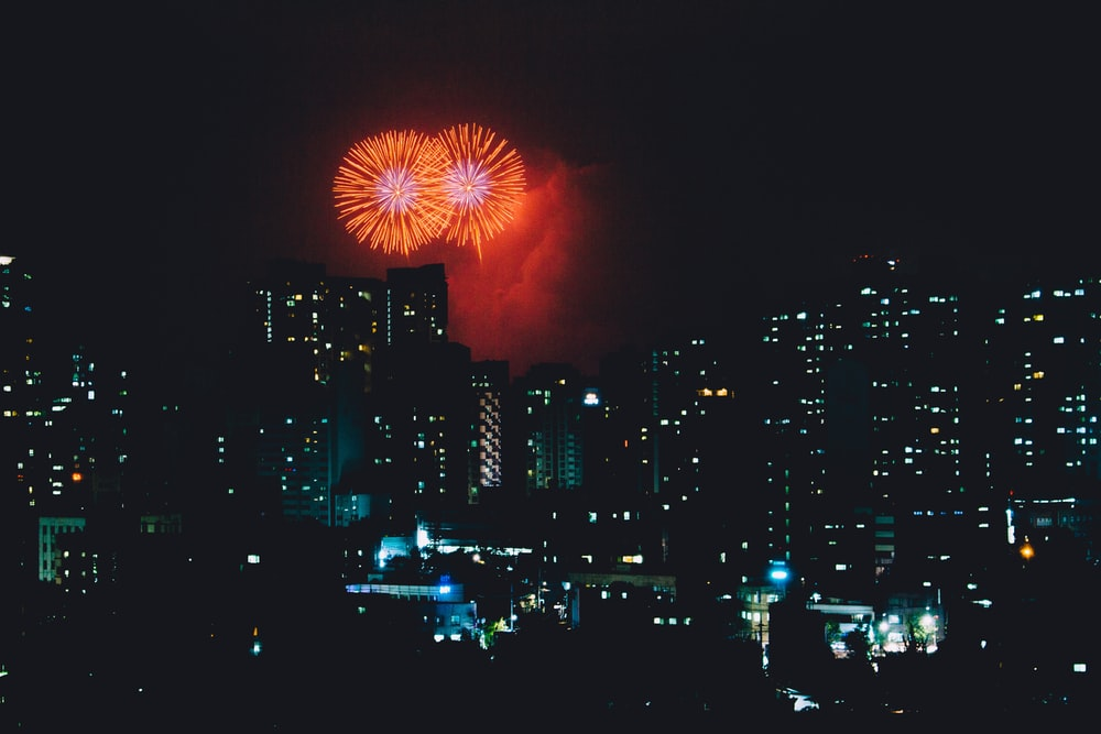 high-rise buildings and fireworks display