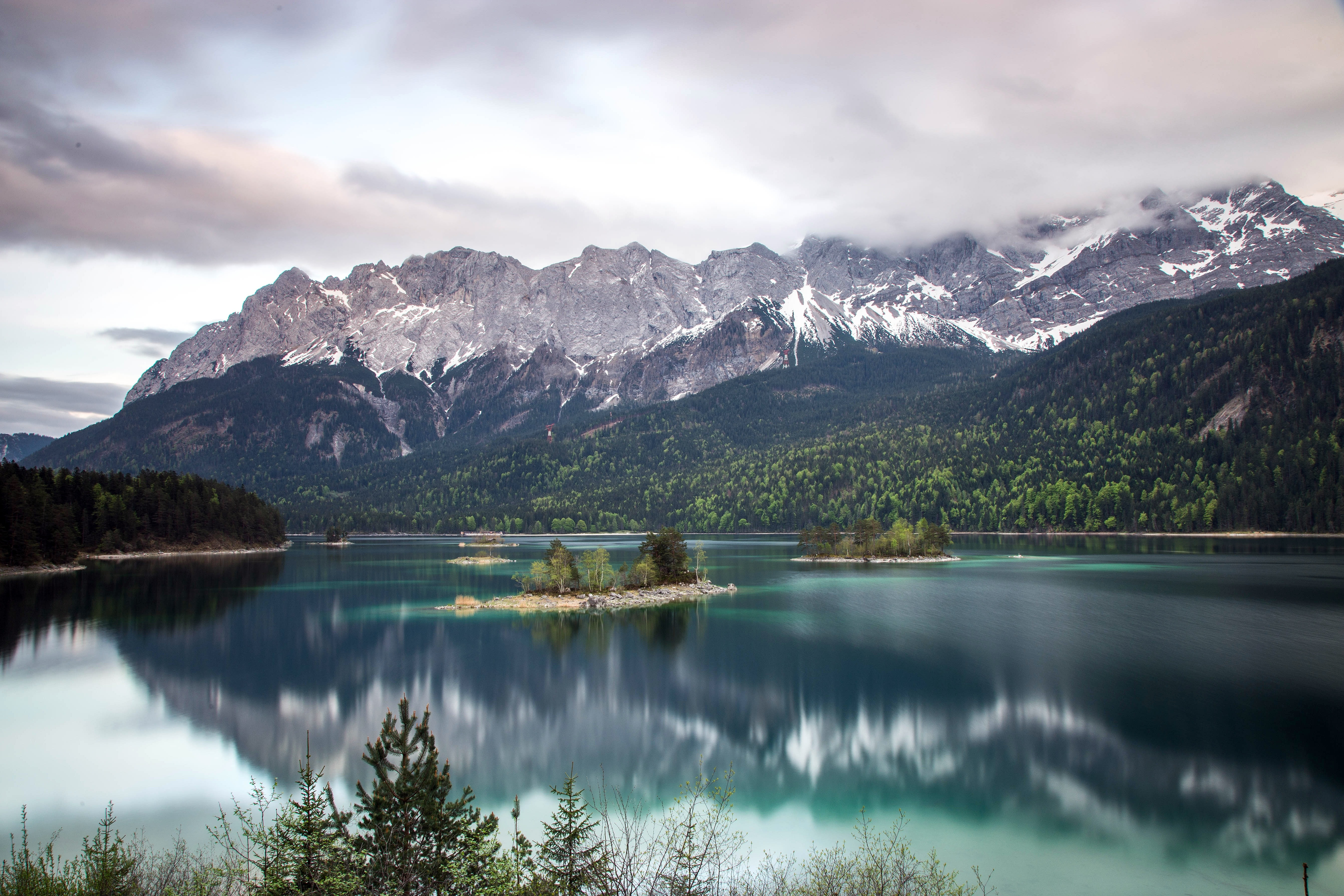 The emerald-green surface of the Eibsee lake in the Alps