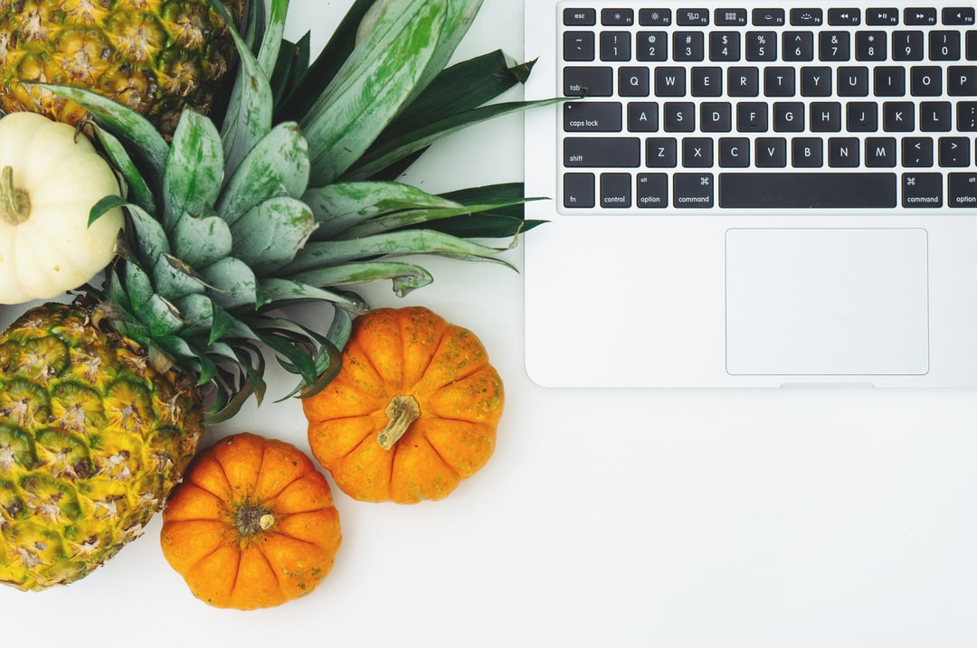Pineapple, Pumpkins and laptop flat lay