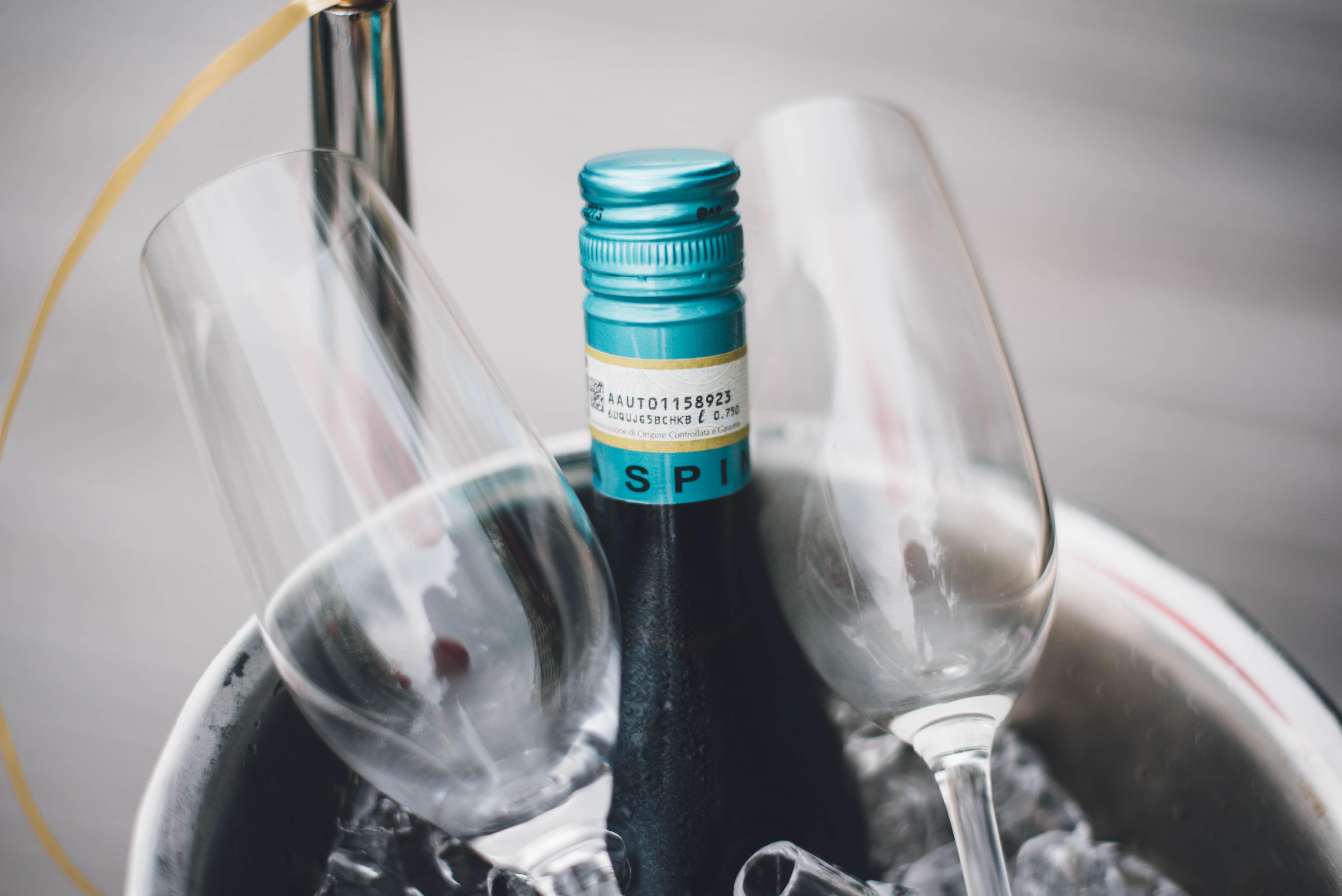 wine bottle beside two flute glasses in macro photography