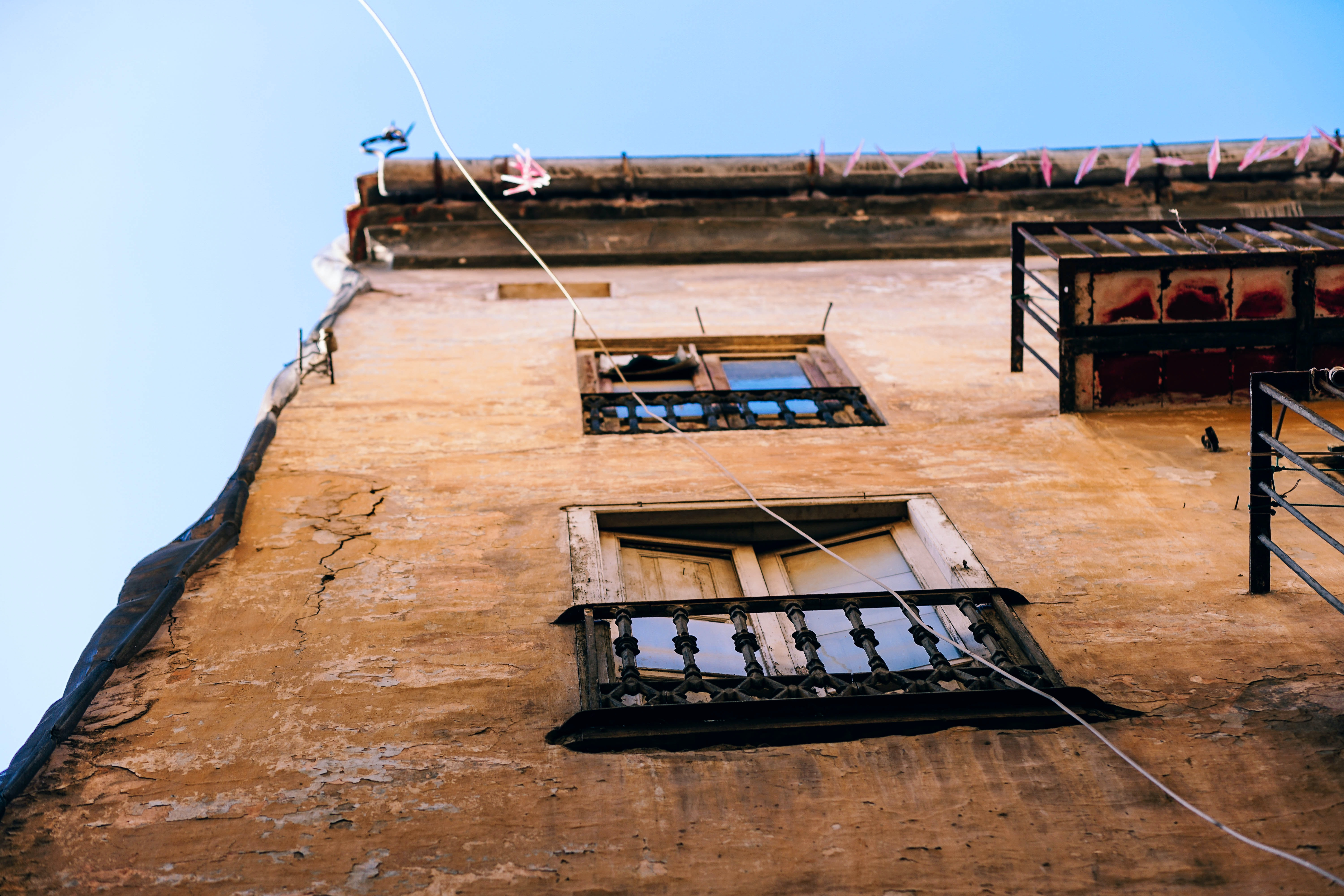 A low-angle shot of the dilapidated facade of an old building