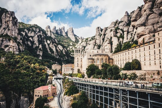 Mountain, building, rock formation and abbey. Monestir de Montserrat, Spain. @pichier_sebastian, unsplash.com