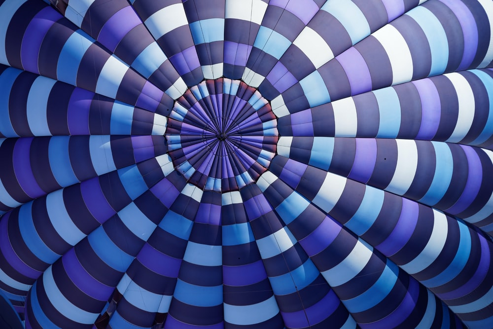 purple, sky-blue, white, and black stripe textile