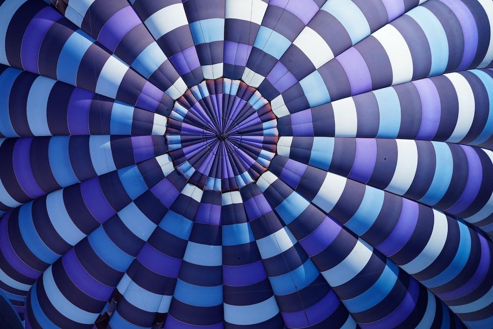 purple, sky-blue, white, and black stripe textile