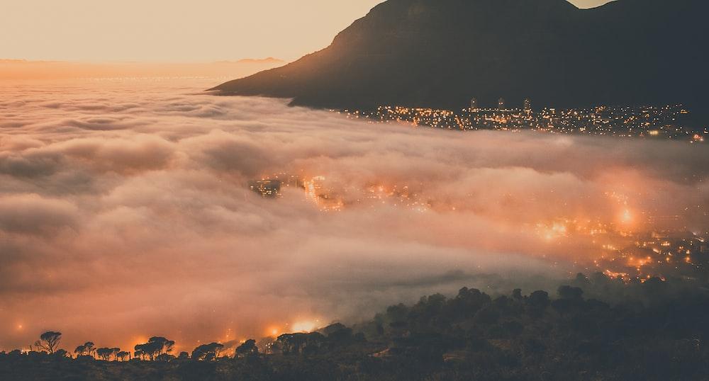 cloudy mountain during sinsunset