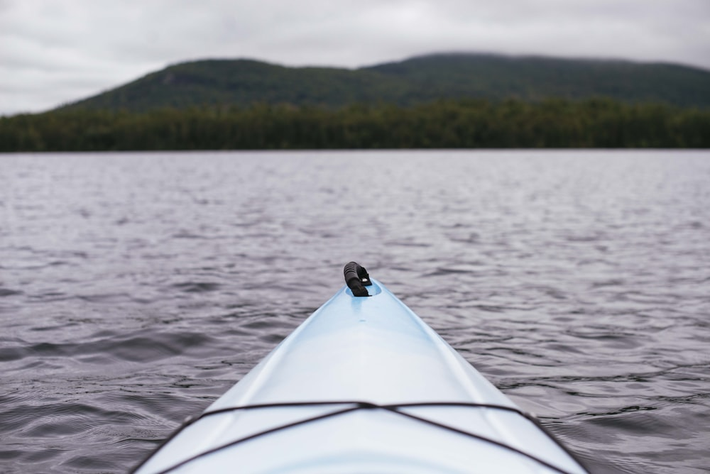 point of view photography of kayak on lake