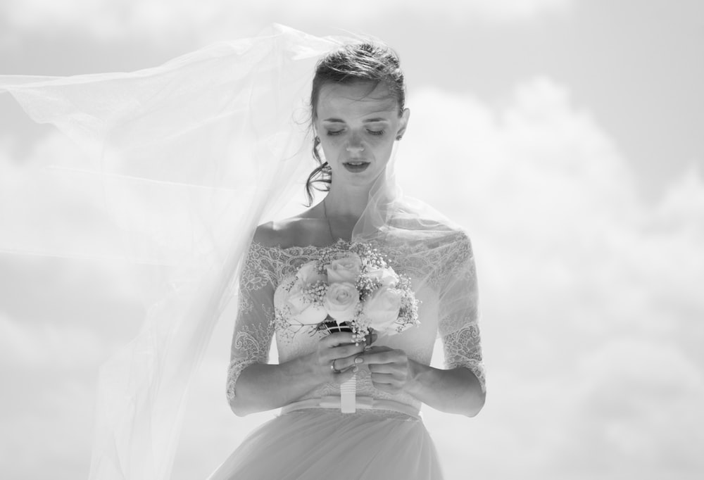 9d1cf26b7b7 grayscale picture of bride holding flower bouquet