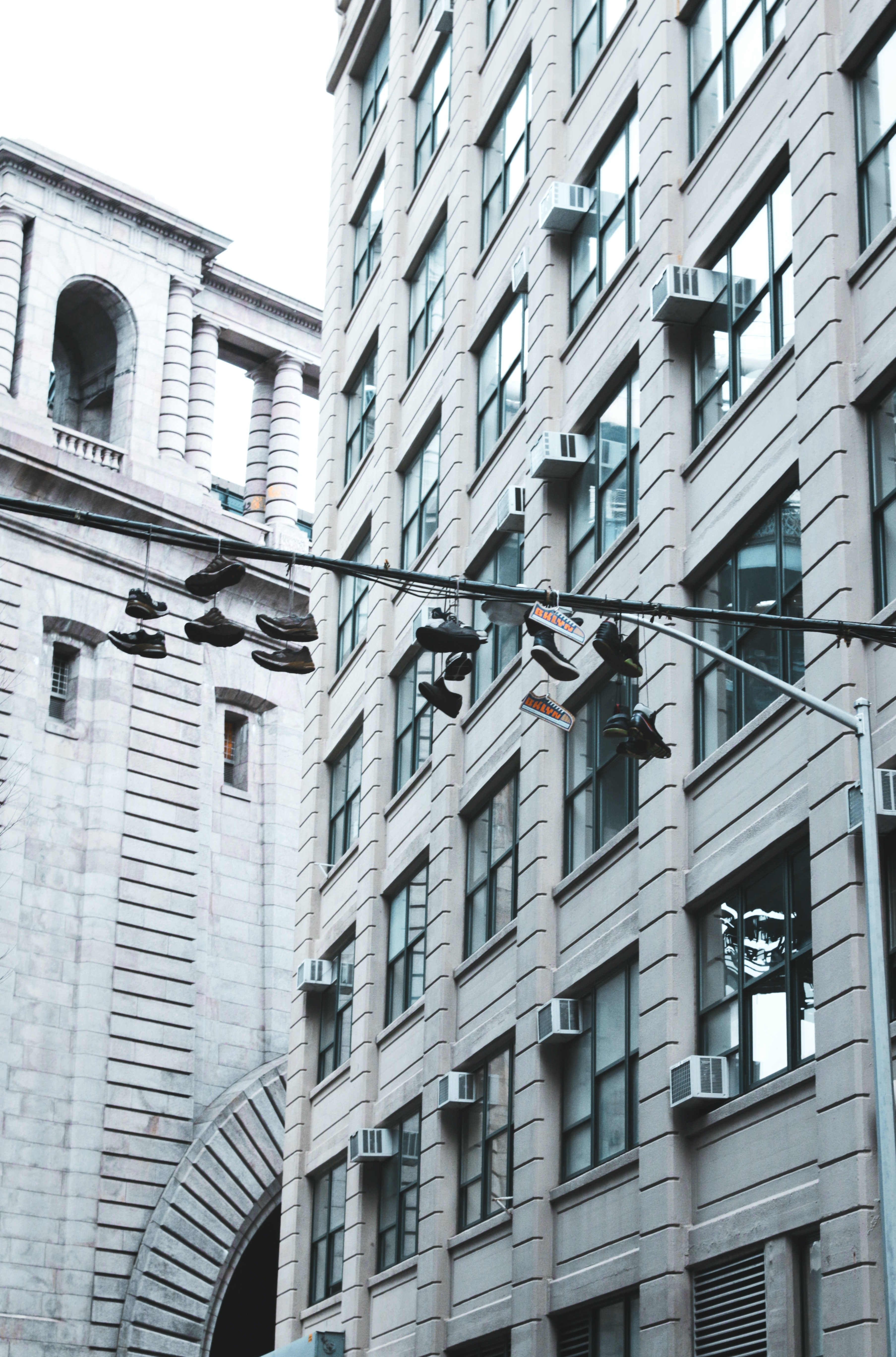 shoes hanging on street pole